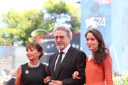 (L-R) Ariane Ascaride, Robert Guediguian and Anais Demoustier walk the red carpet ahead of the 'The House By The Sea (La Villa)' screening during the 74th Venice Film Festival at Sala Grande on September 3, 2017 in Venice, Italy.