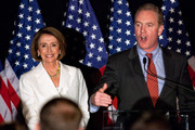 House Speaker Rep. Nancy Pelosi (D-CA) (L) listens as Rep. Chris Van Hollen (D-MD), chairman of the Democratic Congressional Campaign Committee, speaks at an election-night rally held by the DCCC on November 2, 2010 in Washington, DC. Congressional Democrats were expected to suffer big losses in the midterm elections, with Republicans poised to gain control of the House.