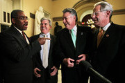 (L-R) U.S. Rep. Gregory Meeks (D-NY), New York State Suffolk County Executive Steve Bellone, U.S. Rep. Peter King (R-NY) and U.S. Rep. Steve Israel (D-NY) share a moment as they are interviewed by members of the media after a vote on the final passage of Disaster Relief Appropriations January 15, 2013 on Capitol Hill in Washington, DC. The House has approved the $50 billion Disaster Relief Appropriations for victims of superstorm Sandy.