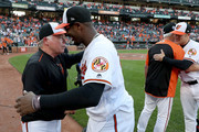 Manager Buck Showalter #26 hugs Adam Jones #10 of the Baltimore Orioles following the Orioles 4-0 win over the Houston Astros at Oriole Park at Camden Yards on September 30, 2018 in Baltimore, Maryland.