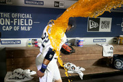 Robinson Cano #22 of the Seattle Mariners dodges a Gatorade bath by Jean Segura #2 of the Seattle Mariners after hitting a three run home run to win the game 7-4 in the eighth inning against the Houston Astros during their game at Safeco Field on August 20, 2018 in Seattle, Washington.