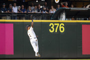 Denard Span #4 of the Seattle Mariners makes a behind-the-back catch on a ball hit by Kyle Tucker #3 of the Houston Astros in the third inning at Safeco Field on July 31, 2018 in Seattle, Washington.
