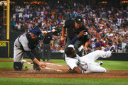 Denard Span #4 of the Seattle Mariners sides into home safely against Max Stassi #12 of the Houston Astros in the sixth inning at Safeco Field on July 30, 2018 in Seattle, Washington.