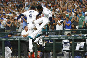 Denard Span #4 of the Seattle Mariners celebrates with Dee Gordon #9 after scoring on a double by Nelson Cruz #23 (not pictured) in the sixth inning against the Houston Astros at Safeco Field on July 30, 2018 in Seattle, Washington.