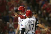 Shin-Soo Choo #17 of the Texas Rangers congratulates Drew Stubbs #15 for scoring in the seventh inning against the Houston Astros at Global Life Park in Arlington on September 17, 2015 in Arlington, Texas.