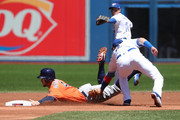 George Springer #4 of the Houston Astros is caught stealing second base as Troy Tulowitzki #2 of the Toronto Blue Jays tags him out in the first inning during MLB game action at Rogers Centre on July 8, 2017 in Toronto, Canada.