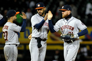 (L-R) Jose Altuve #27 of the Houston Astros, Marwin Gonzalez #9, and Derek Fisher #21 celebrate their win against the Chicago White Sox at Guaranteed Rate Field on April 21, 2018 in Chicago, Illinois. The Houston Astros won 10-1.