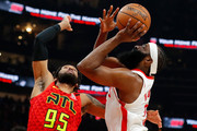 James Harden #13 of the Houston Rockets draws a foul as he drives against DeAndre' Bembry #95 of the Atlanta Hawks in the first half at State Farm Arena on January 08, 2020 in Atlanta, Georgia.  NOTE TO USER: User expressly acknowledges and agrees that, by downloading and/or using this photograph, user is consenting to the terms and conditions of the Getty Images License Agreement.