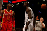 Dwight Howard #12 of the Houston Rockets and Kevin Garnett #2 of the Brooklyn Nets exchange words in the first quarter at the Barclays Center on January 12, 2015 in the Brooklyn borough of New York City. Garnett was ejected from the game. NOTE TO USER: User expressly acknowledges and agrees that, by downloading and/or using this photograph, user is consenting to the terms and conditions of the Getty Images License Agreement.