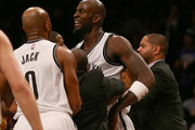 Kevin Garnett #2 of the Brooklyn Nets is held back as he and Dwight Howard of the Houston Rockets get into a fight at the Barclays Center on January 12, 2015 in the Brooklyn borough of New York City. NOTE TO USER: User expressly acknowledges and agrees that, by downloading and/or using this photograph, user is consenting to the terms and conditions of the Getty Images License Agreement.