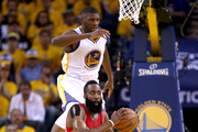 James Harden #13 of the Houston Rockets with the ball as Festus Ezeli #31 of the Golden State Warriors jumps in the air in the first half during game five of the Western Conference Finals of the 2015 NBA Playoffs at ORACLE Arena on May 27, 2015 in Oakland, California. NOTE TO USER: User expressly acknowledges and agrees that, by downloading and or using this photograph, user is consenting to the terms and conditions of Getty Images License Agreement.