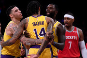 Lonzo Ball #2 and Lance Stephenson #6 of the Los Angeles Lakers restrain Brandon Ingram #14 from Carmelo Anthony #7 of the Houston Rockets during a 124-115 loss to the Houston Rockets at Staples Center on October 20, 2018 in Los Angeles, California.