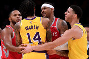 Carmelo Anthony #7 and Eric Gordon #10 of the Houston Rockets restrain Brandon Ingram #14 of the Los Angeles Lakers with the help of Lonzo Ball #2 during a 124-115 Rockets win at Staples Center on October 20, 2018 in Los Angeles, California.