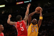 Kobe Bryant #24 of the Los Angeles Lakers takes a shot against Courtney Lee #5 of the Houston Rockets during their opening night game at Staples Center on October 26, 2010 in Los Angeles, California. NOTE TO USER: User expressly acknowledges and agrees that, by downloading and or using this photograph, User is consenting to the terms and conditions of the Getty Images License Agreement.