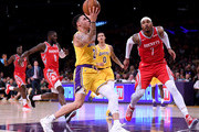 Lonzo Ball #2 of the Los Angeles Lakers drives to the basket in front of Carmelo Anthony #7 of the Houston Rockets during a 124-115 Rockets win at Staples Center on October 20, 2018 in Los Angeles, California.