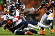 Wide receiver Braxton Miller #13 of the Houston Texans is tackled by linebacker Dekoda Watson #57 of the Denver Broncos tackles in the second quarter of the game at Sports Authority Field at Mile High on October 24, 2016 in Denver, Colorado.