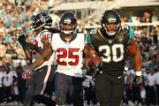 Corey Grant #30 of the Jacksonville Jaguars runs for an 8-yard touchdown during the second half of their game against the Houston Texans at EverBank Field on December 17, 2017 in Jacksonville, Florida.