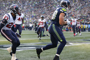 Tight end Jimmy Graham #88 of the Seattle Seahawks pulls in a touchdown against safety Kurtis Drummond #23 of the Houston Texans during the fourth quarter of the game at CenturyLink Field on October 29, 2017 in Seattle, Washington.