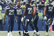 Free safety Earl Thomas #29 of the Seattle Seahawks is congratulated on his interception for a touchdown by Doug Baldwin #89 during the first quarter of the game against the Houston Texans at CenturyLink Field on October 29, 2017 in Seattle, Washington.