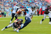 Quarterback Blaine Gabbert #7 of the Tennessee Titans dodges J.J. Watt #99 of the Houston Texans during the second half at Nissan Stadium on September 16, 2018 in Nashville, Tennessee.