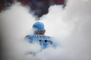 Ryan Tannehill #17 of the Tennessee Titans runs out of the tunnel amidst smoke before the game against the Houston Texans at Nissan Stadium on December 15, 2019 in Nashville, Tennessee.
