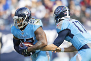 Derrick Henry #22 takes the hand off from Ryan Tannehill #17 of the Tennessee Titans in the first half of a game against the Houston Texans at Nissan Stadium on December 15, 2019 in Nashville, Tennessee.