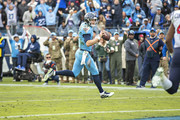 Ryan Tannehill #17 of the Tennessee Titans runs the ball in for a touchdown during the second half of a game against the Houston Texans at Nissan Stadium on December 15, 2019 in Nashville, Tennessee.  The Texans defeated the Titans 24-21.