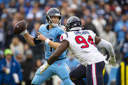 Ryan Tannehill #17 of the Tennessee Titans looks for receivers as he is pressured by Charles Omenihu #94 of the Houston Texans during the third quarter at Nissan Stadium on December 15, 2019 in Nashville, Tennessee. Houston defeats Tennessee 24-21.