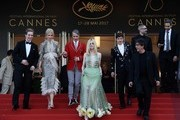 (FromL) British actor Abraham Lewis, Australian actress Nicole Kidman, US director John Cameron Mitchell, US actress Elle Fanning, British actor Alex Sharp and British author Neil Gaiman leave the Festival Palace on May 21, 2017 following the screening of the film 'How to talk to Girls at Parties' at the 70th edition of the Cannes Film Festival in Cannes, southern France.  / AFP PHOTO / Anne-Christine POUJOULAT