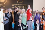 (Back, 4thL) British author Neil Gaiman, Australian actress Nicole Kidman, US actress Elle Fanning, British costume designer Sandy Powell, actress Eloise Smyth, (bottom fromL) British actor Abraham Lewis, US director John Cameron Mitchell and British actor Alex Sharp pose as they arrive on May 21, 2017 for the screening of the film 'How to talk to Girls at Parties' at the 70th edition of the Cannes Film Festival in Cannes, southern France.  / AFP PHOTO / Valery HACHE