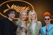 (From L) British novelist Neil Gaiman, Australian actress Nicole Kidman, US actress Elle Fanning and British costume designer Sandy Powell pose as they arrive on May 21, 2017 for the screening of the film 'How to talk to Girls at Parties' at the 70th edition of the Cannes Film Festival in Cannes, southern France.  / AFP PHOTO / Alberto PIZZOLI