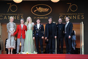 """(L-R)  Nicole Kidman, John Cameron Mitchell, Elle Fanning, Alex Sharp, Neil Gaiman, guest and  Howard Gertler depart after the """"How To Talk To Girls At Parties"""" screening during the 70th annual Cannes Film Festival at Palais des Festivals on May 21, 2017 in Cannes, France."""