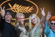 (From L) British novelist Neil Gaiman, Australian actress Nicole Kidman, US actress Elle Fanning and British costume designer Sandy Powell gesture as they arrive on May 21, 2017 for the screening of the film 'How to talk to Girls at Parties' at the 70th edition of the Cannes Film Festival in Cannes, southern France.  / AFP PHOTO / Alberto PIZZOLI