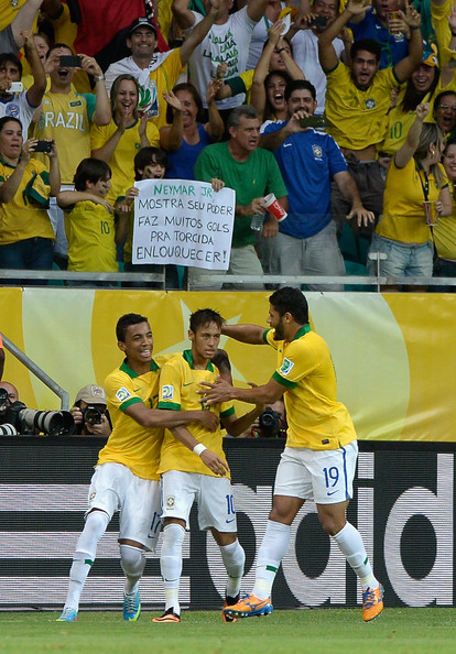 Italy v Brazil: Group A - FIFA Confederations Cup Brazil 2013 [player,sport venue,team,product,championship,stadium,sports,team sport,football player,yellow,neymar,luiz gustavo,hulk,group a,goal,brazil,italy,arena fonte nova salvador,fifa confederations cup,free kick]