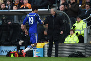Diego Costa of Chelsea shakes hands with Jose Mourinho manager of Chelsea as he is substituted during the Barclays Premier League match between Hull City and Chelsea at KC Stadium on March 22, 2015 in Hull, England.