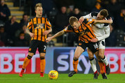Andreas Weimann (R) of Derby County is challenged by Sebastian Larsson (L) of Hull City during the Sky Bet Championship match between Hull City and Derby County at KCOM Stadium on December 26, 2017 in Hull, England.