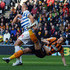 Michael Dawson of Hull City challenges Bobby Zamora of QPR during the Barclays Premier League match between Hull City and Queens Park Rangers at KC Stadium on February 21, 2015 in Hull, England.