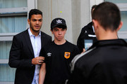New Hull City signing Hatem Ben Arfa (l) poses for a picture with a fan before the Barclays Premier League match between Hull City and West Ham United at KC Stadium on September 15, 2014 in Hull, England.