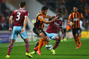 Hatem Ben Arfa of Hull City battles with Alex Song of West Ham United during Barclays Premier League match between Hull City and West Ham United at KC Stadium on September 15, 2014 in Hull, England.