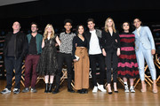 L-R Executive producers Jeph Loeb, Josh Schwartz, and Stephanie Savage and actors Rhenzy Feliz, Lyrica Okano, Gregg Sulkin, Virginia Gardner, Ariela Barer, and Allegra Acosta pose onstage after Hulu's Runaways panel at New York Comic Con at Jacob Javits Center on October 6, 2017 in New York City.