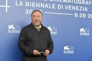 """Chinese artist and producer Ai Weiwei attends the photocall of the movie """"Human Flow"""" presented in competition at the 74th Venice Film Festival on September 1, 2017 at Venice Lido.  / AFP PHOTO / Tiziana FABI"""