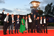Niels Pagh Andersen (3rd R), Diane Weyermann (C), Christopher Doyle (4th R), Ai Weiwei (2nd R) and guests walk the red carpet ahead of the 'Human Flow' screening during the 74th Venice Film Festival at Sala Grande on September 1, 2017 in Venice, Italy.