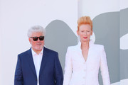 """Director Pedro Almodóvar and Tilda Swinton walk the red carpet ahead of the movie """"The Human Voice"""" and """"Quo Vadis, Aida?"""" at the 77th Venice Film Festival at  on September 03, 2020 in Venice, Italy."""