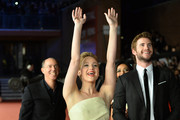 (L-R) Producer Jon Kilik, actors Jennifer Lawrence and Liam Hemsworth attend the 'The Hunger Games: Catching Fire' Premiere during The 8th Rome Film Festival at Auditorium Parco Della Musica on November 14, 2013 in Rome, Italy.