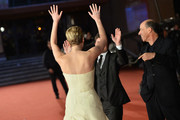 Actors Jennifer Lawrence, Josh Hutcherson and.producer Jon Kilik attend the 'The Hunger Games: Catching Fire' Premiere during The 8th Rome Film Festival at Auditorium Parco Della Musica on November 14, 2013 in Rome, Italy.