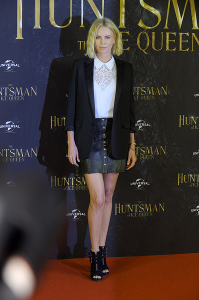 Charlize Theron paired a black Saint Laurent blazer with a white lace shirt for the photocall for 'The Huntsman & The Ice Queen.'