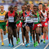 Isiah Kiplangat Koech of Kenya and Mo Farah of Great Britain lead the pack in the Men's 5000 metres final during Day Seven of the 14th IAAF World Athletics Championships Moscow 2013 at Luzhniki Stadium at Luzhniki Stadium on August 16, 2013 in Moscow, Russia.