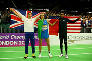 (L-R) Silver medallist Robert Grabarz of Great Britain,gold medallist Gianmarco Tamberi of Italy and bronze medallist Erik Kynard of the United States celebrate after the Men's High Jump Final during day three of the IAAF World Indoor Championships at Oregon Convention Center on March 19, 2016 in Portland, Oregon.