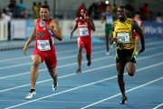 Ryan Bailey of the United States and Usain Bolt of Jamaica compete during the final of the menÂ's 4 x 100 metres on day one of the IAAF World Relays at Thomas Robinson Stadium on May 2, 2015 in Nassau, Bahamas.