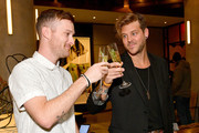 """Jeff Johnson and Andrew Slyfox attend """"A Toast To Travel"""" presented by the IHG Rewards Club at Kimpton Hotel Eventi on November 28, 2018 in New York City."""